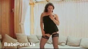 Horny brunette is rubbing her cock between her huge tits, on the floor until she cums